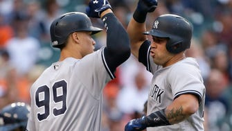 New York Yankees' Gary Sanchez celebrates his solo home run against the Detroit Tigers with teammate Aaron Judge (99) during the first inning of a baseball game Wednesday, Aug; 23, 2017, in Detroit.