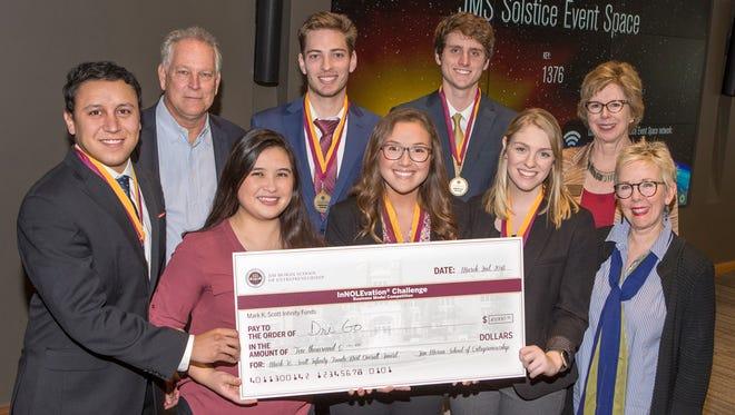The DriGo team of FAMU-FSU College Engineering students won $10,000 for its wheelchair umbrella.