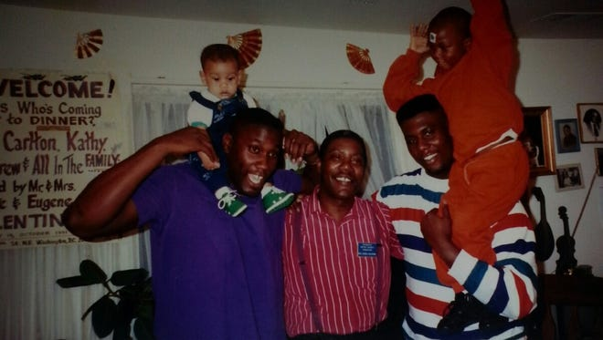 Carlton Valentine, left, poses with son Drew on his shoulders, next to father Eugene, center, and brother Eugene Jr., who has his son Robert on his shoulders, in a photo believed to be taken sometime in 1992 in Washington, D.C. Denzel was born in 1993. Both Eugene Sr. and Robert, now 28, will be at Friday night's MSU opener at Navy, along with Carlton and wife, Kathy.