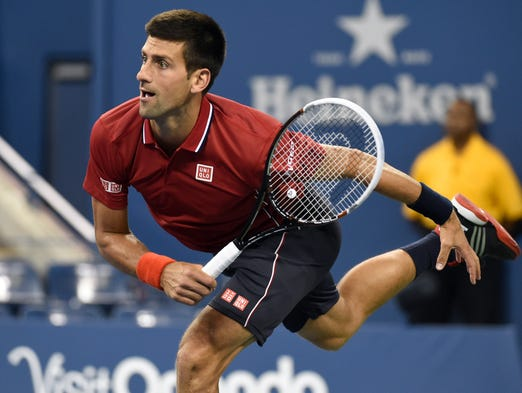 Novak Djokovic hits to Diego Schwartzman in Ashe Stadium.