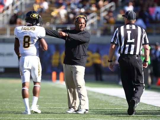 Sep 5, 2015; Berkeley, CA, USA; Grambling State Tigers head coach Broderick Fobbs speaks to the referee with wide receiver Dominique Leake (8) during the third quarter against the California Golden Bears at Memorial Stadium. The California Golden Bears defeated the Grambling State Tigers 73-14. Mandatory Credit: Kelley L Cox-USA TODAY Sports