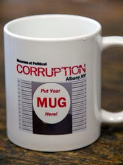 In this Nov. 19, 2015 photo, a mug from the Museum of Political Corruption is seen in Albany, N.Y.