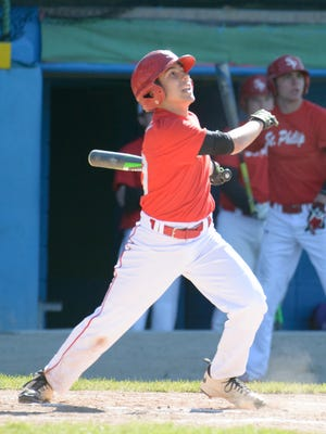 St. Philip's Jon Van Niekerk (30) at bat during Monday night's annual Pay 4 May event held at CO Brown Stadium.