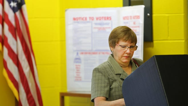 Debbie Ecklar, casts her vote at John G. Carlisle School in Covington during the Kentucky Primary.