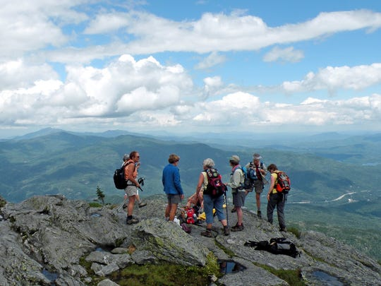 Hikers gather on top of Camels Hump.
