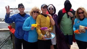 """Fort Pierce Yacht Club hosted 25 boats and 115 poker players April 22 to raise money tofund a summer intern scholarship at FAU Harbor Branch Oceanographic Institute. Members of the """"USS Enterprise"""" won the award for Best Themed Boat."""