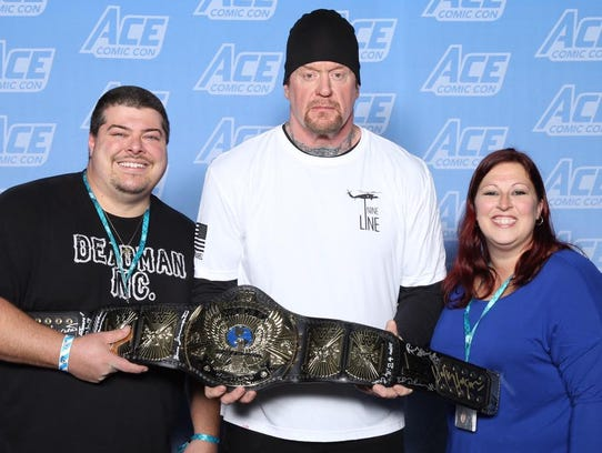 Newark's Steve and Tammy Ketterer with wrestler The