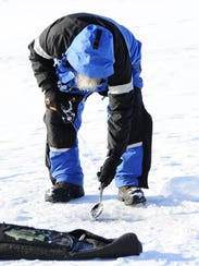 Gary Newell, of Lexington, scoops ice chunks while