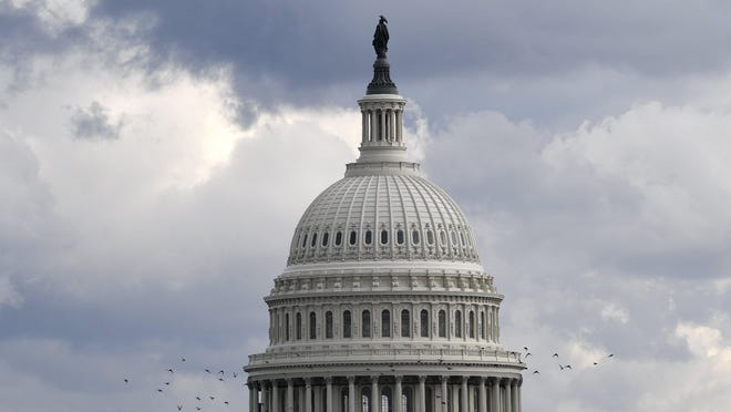 This photo shows a view of the U.S. Capitol Building in Washington, Tuesday, Dec. 31, 2019.