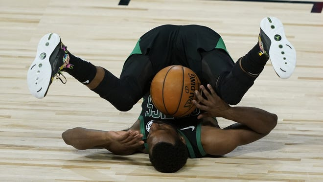 Boston Celtics' Kemba Walker falls after being fouled during the second half of an NBA basketball first round playoff game against the Philadelphia 76ers on Aug. 17, 2020, in Lake Buena Vista, Fla. Walker will play in his first Eastern Conference finals starting on Tuesday.