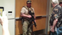 SWAT members ordered attendees at an art exhibit in