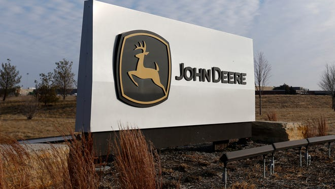 Deere and Co. has proposed buying Monsanto's Precision Planting equipment unit, a deal the Justice Department says would stifle competition and increase costs.