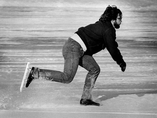 Rick Battaglia skates across the lake at Cobbs Hill Park in 1979.