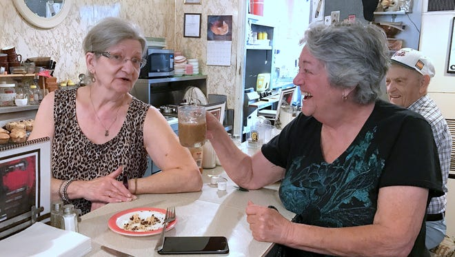 Donna's Restaurant owner Donna Robbins, left, chats with longtime customer Kitty Erlacher during the breakfast rush Thursday.