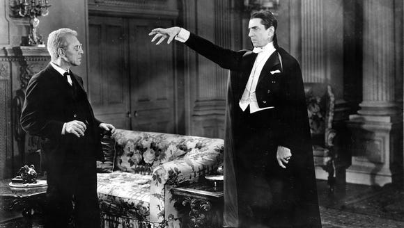 Dracula (Bela Lugosi, right) tries to put a whammy