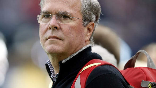 Jeb Bush watches the pregame warmup of the Houston Texans before their game against the Oakland Raiders in the AFC Wild Card game at NRG Stadium on Jan. 7, 2017 in Houston, Texas.