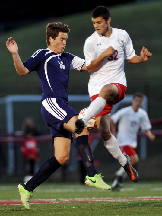 Dallastown's Ben Doorn, left, and Susquehannock's Dan Snyder fight for possession in the first half of their Sept. 18 match at Susquehannock. (DAILY RECORD/SUNDAY NEWS -- CHRIS DUNN )