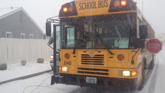 File photo: Students board a Washoe school bus on a snowy day in 2013.