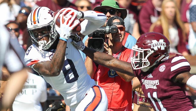 Auburn wide receiver Tony Stevens (8) catches a pass against Mississippi State defender Markell Boston (11) during an NCAA college football game at Davis Wade Stadium at Scott Field in Starkville, Miss., Saturday, Oct. 8, 2016. Auburn won 38-14. (James Pugh/The Laurel Chronicle, via AP)
