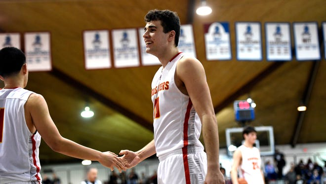 Bergen Catholic's Gabe Stefanini is all smiles after the Crusaders' win. Bergen Catholic defeated Teaneck 71-61 in the Bergen County Jamboree semifinal round at the Fairleigh Dickinson University Rothman Center in Hackensack on Sunday.