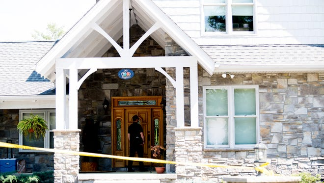 The scene outside of a home at 163 Kelly Ridge Road where a hostage situation resulted in the death of two individuals in the Laurel Valley area in Townsend, Tennessee on Saturday, May 12, 2018.