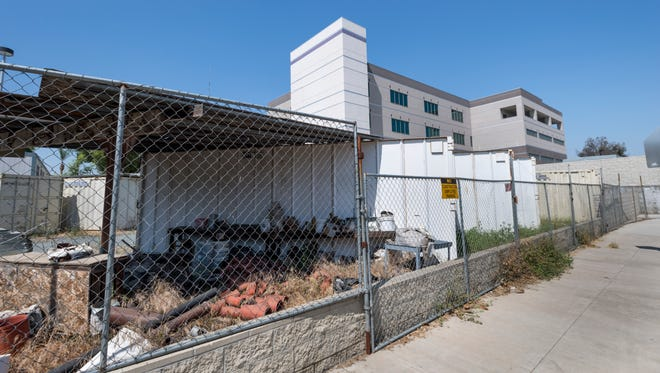 Construction materials lay dormant outside the new tower of the Tulare Regional Medical Center on Wednesday, May 23, 2018.