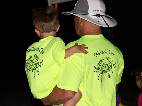 Levi Hughes embraces his dad, Jonathan, during the family's annual vacation to Fort Morgan, Ala. Every year the Hughes would go on vacation with a group of close family friends — 12 adults and 17 children in all. One of the special activities was nighttime crab hunting. The dads -- all doctors who completed their residencies together -- had special shirts made for the occasion. Levi Hughes drown in the beach house swimming pool on June 10, 2018, just before a crab hunt. He was wearing his yellow crab-hunting shirt.