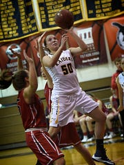 Elco's Ryelle Shuey drives between two Annville-Cleona