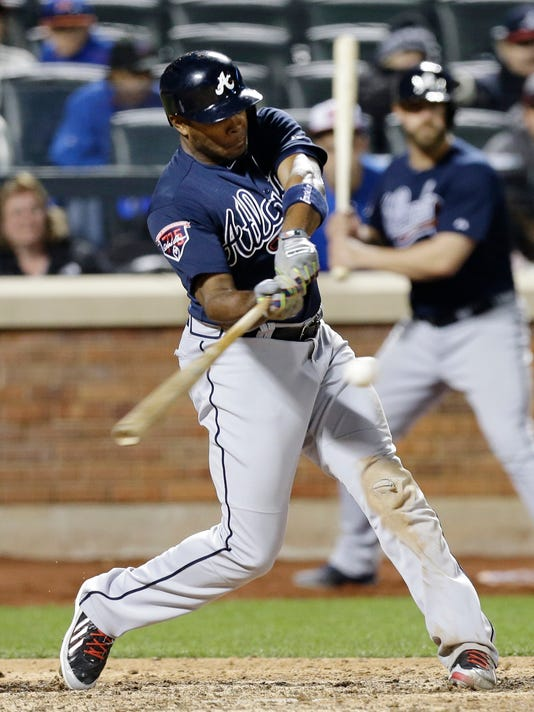 Atlanta Braves' Justin Upton hits a three-run home run during the ninth inning of a baseball game against the New York Mets, Saturday, April 19, 2014, in New York. (AP Photo/Frank Franklin II)