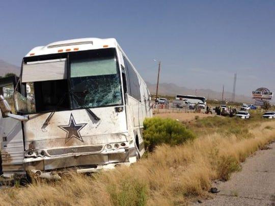 A scene from the site of a crash involving a Dallas Cowboys bus near Dolan Springs, Ariz.