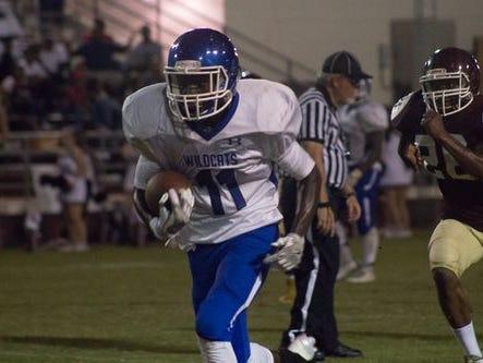 Washington's Mystical McGhee works his way up field last Friday vs. Pensacola High.