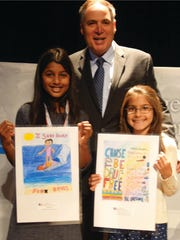 Left to right: Students from Campbell Elementary School. Anika Kundu with  PDFNJ's executive director, Angelo Valents and Humera Delia Alisammond