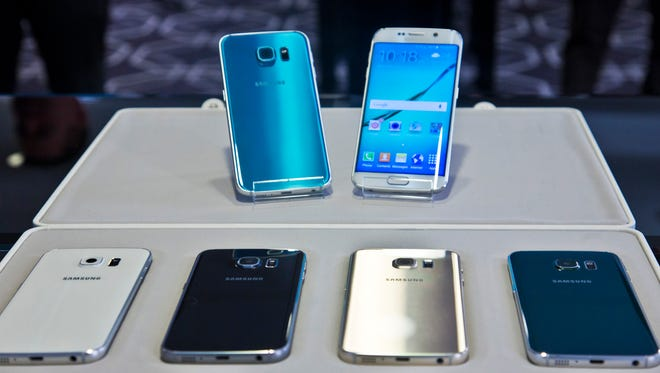 In this Feb. 23, 2015, file photo, two new Samsung phones, Galaxy S6, top left, and Galaxy S6 Edge, to right, are on display with choice of color selections at a special media preview in New York.
