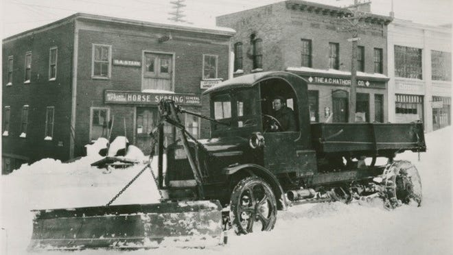 Truck with plow blade on South Winooski Avenue in Burlington, probably in the 1920s.