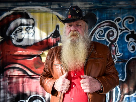 Denzel Irwin, aka Santa, stands on the outside deck at Santa's Pub on Thursday  Dec.15, 2016 in Nashville, Tenn. Irwin opened Santa's Pub in 2011, because he needed to do something after retiring.