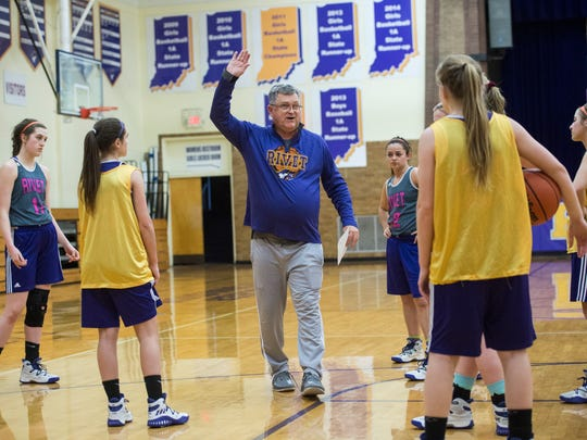 Rivet girls basketball coach Rick Marshall addresses