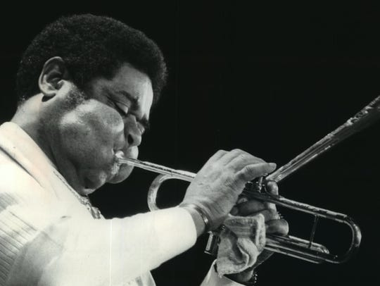 Jazz trumpeter Dizzy Gillespie blasts on his distinctive