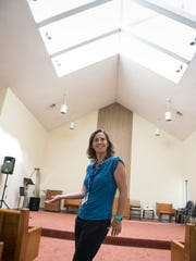 Assistant chaplain Shannon Spencer cuts up in the chapel