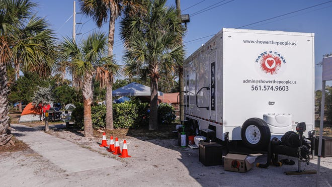 The Dare2Care mobile shower unit set up just outside the homeless tent city at John Prince Park Saturday morning, April 4, 2020.