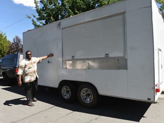 Stephon VanDyke stands next to his food truck showing where an advertisement was painted over when it was was stolen and vandalized. VanDyke estimates it will cost him $10,000 and $15,000 to repair the damage. The food truck is his only source of income.