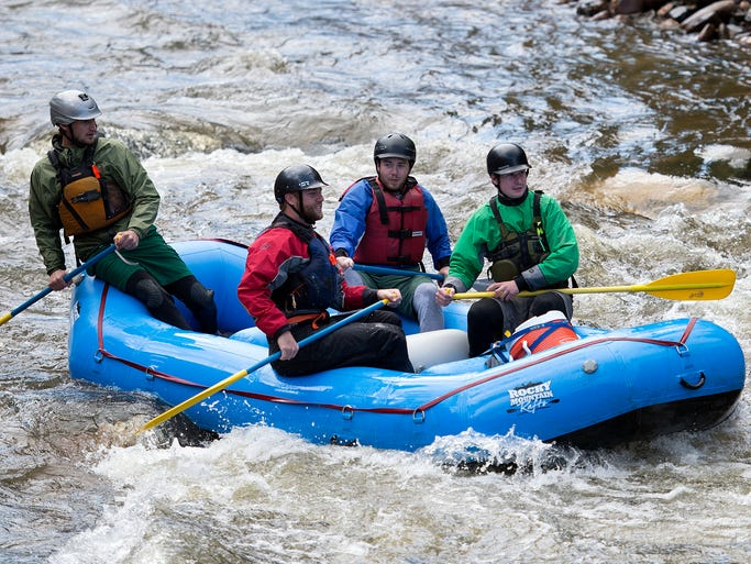 Rafters float down the canyon on the Poudre River on first day of the commercial rafting seasonThursday, May 15, 2014.
