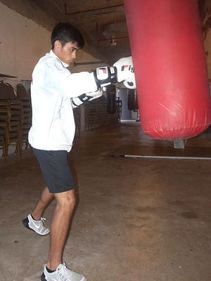 Guam boxer Adrienne Francisco is preparing to compete at the 2015 Pacific Games, which will be held next month in Papua New Guinea. The fighter trains at Lights Out Gym.
