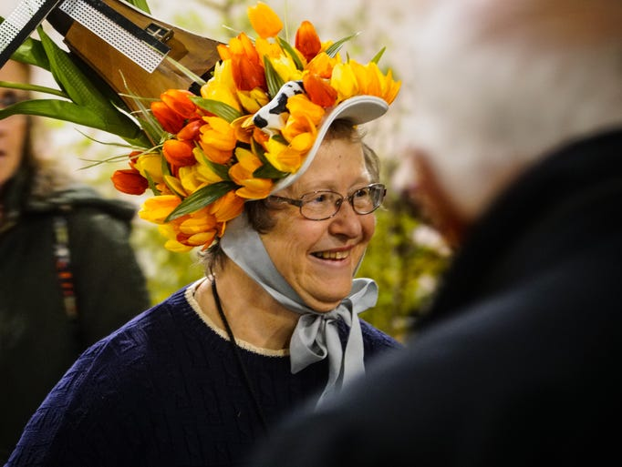 Karen Snyder wore her tulip hat to greet visitors at