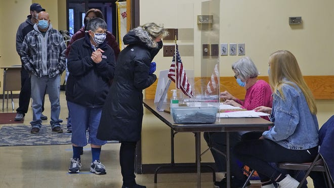 Voters lined up to cast their ballots at Holy Rosary Church parish center in Taunton on Tuesday, Nov. 3, 2020. Taunton Gazette | Mike Gay
