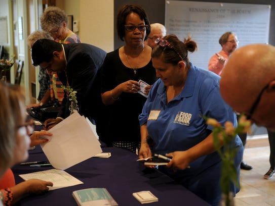 People check in at the Catholic Charities Fort Worth