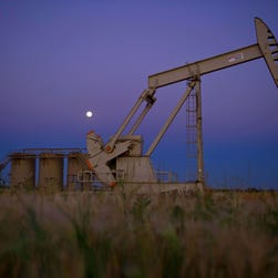 (FILES) This August 21, 2013 file photo shows an oil well near Tioga, North Dakota.  Big winners in the US shale-oil boom, energy services providers now are slashing jobs to preserve their profits and margins from the rapid dive in oil prices. Over the past month, the sector's three largest companies have announced 17,000 job cuts in the oil patch even as they notched up robust earnings in 2014. Schlumberger, the world's largest oilfield services company, has ordered the lion's share of layoffs: 9,000, or 7.5 percent of its workforce. Baker Hughes, the number three firm, which is being acquired by number-two Halliburton, is shedding 7,000 employees, representing 11.3 percent of its staff, with most of them to be shown the door by the end of March. AFP PHOTO / Karen BLEIERKAREN BLEIER/AFP/Getty Images ORG XMIT: - ORIG FILE ID: 536960073