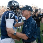 Former Wolf Pack football coach Chris Ault, right, is greeted by quarterback Cody Fajardo at the dedication of Chris Ault Field at Mackay Stadium on Sept. 7.
