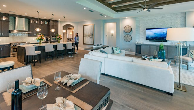 FrontDoor's 3,382-square-foot under air second-floor Sienna coach homes feature a ground-level foyer with a 26-foot clear-story ceiling, an elegant staircase, and a private elevator.