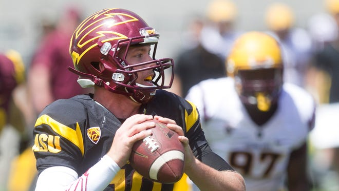 ASU quarterback Taylor Kelly looks to throw during the ASU football spring game at Sun Devil Stadium in Tempe on Saturday, April 19, 2014.