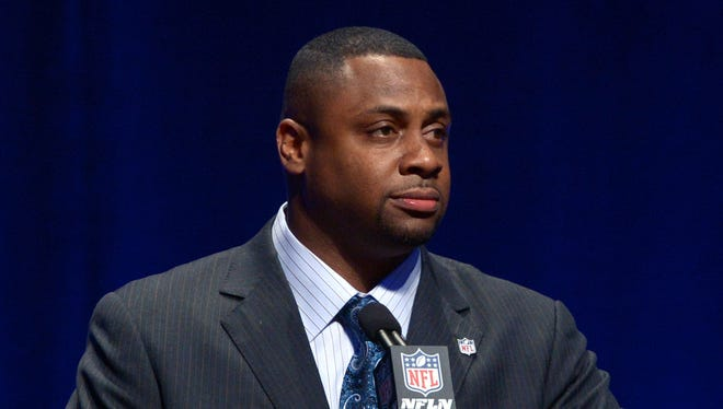 Former NFL player Troy Vincent speaks during a press conference at Rose Theater.